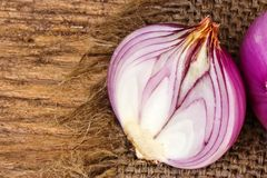 Red onion on sack Royalty Free Stock Image