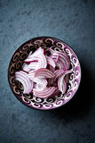 Red onion for salad in a bowl Royalty Free Stock Image