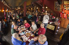 Red Onion Saloon Serves up Nostalgia in Skagway, Alaska. Convivial conversation over food and drink take place at the historic Red Onion Saloon in Skagway Stock Image