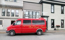 The Red Onion Saloon Vehicle. A red light tour vehicle that takes tourists to the The Red Onion Saloon in the town of Skagway in Alaska Royalty Free Stock Photos