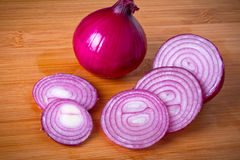 Red onion sliced on cutting board Royalty Free Stock Photo