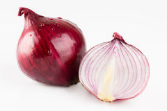 Red onion and slices isolated on white. Background Stock Image