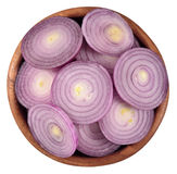 Red onion slices in a wooden bowl on a white Stock Photography