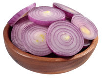 Red onion slices in a wooden bowl on a white Royalty Free Stock Photos