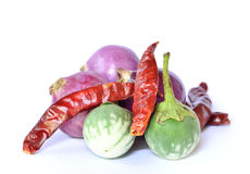Red onion,Thai Green Eggplant,dried red pepper on white backgrou Royalty Free Stock Photo