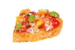 Tomato bruschetta isolated. Red onion and tomato bruschetta isolated against white Royalty Free Stock Image