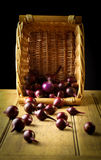 Red onion wicker basket Stock Photography