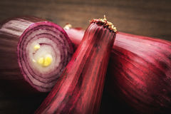 Red onion on wood Royalty Free Stock Image