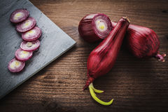 Red onion on wood Royalty Free Stock Photo