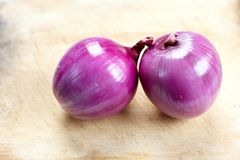 Red onion on wood Stock Photos