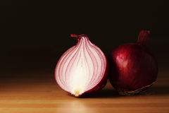 Red onions. Half of a red onion and a whole red onion Royalty Free Stock Photo