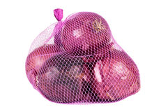 Red onions. In a pink bag over a white background Royalty Free Stock Photos