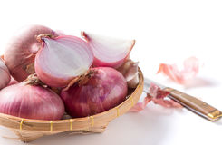 Red onions on bamboo basket isolated on white Stock Image