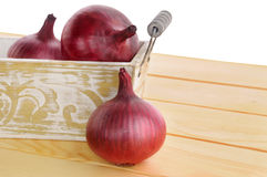 Red onions in basket Royalty Free Stock Photo