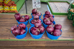 Red onions. Bunch of colorful red onions at the local market Stock Photography