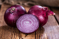 Red Onions (close-up shot). Some fresh Red Onions (close-up shot) on an wooden table Royalty Free Stock Images