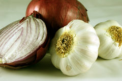 Red Onions and Garlic Cloves. Close-up of red onions and garlic cloves Royalty Free Stock Photo
