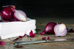 Red onions on a pile of paper tissues Stock Image