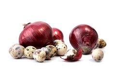 Red onions and quail eggs Stock Photos