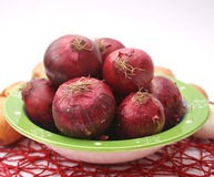 Red onions. Some red onions in a bowl stock images
