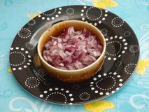 Red Onions. Some fresh red onions in a bowl Stock Photo