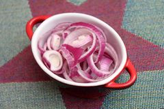 Red onions. Some rings of red onions in a bowl Royalty Free Stock Image