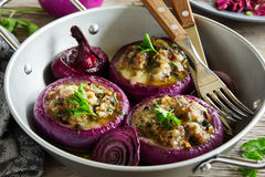 Red onions stuffed with goat cheese Royalty Free Stock Photos