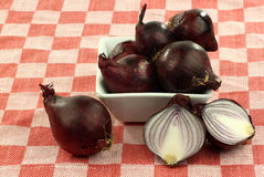 Red onions in a white bowl Royalty Free Stock Photos