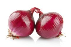 Red onions on white Stock Images