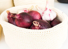 Red onions in a wicker basket close-up Stock Image