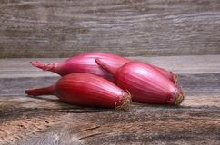Red onions on a wooden background Stock Images