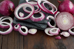 Red onions on a wooden table Stock Images