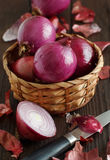 Red onions on a wooden table Royalty Free Stock Images