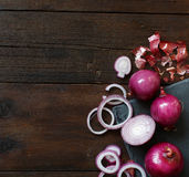Red onions on a wooden table Royalty Free Stock Image