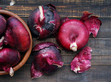 Red onions on a wooden table. Fresh vegetables Stock Photography