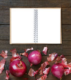 Red onions on a wooden table Royalty Free Stock Photo