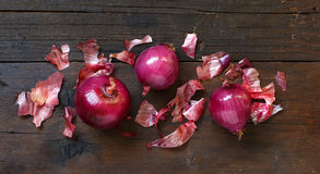 Red onions on a wooden table Stock Photography
