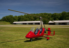 Red open-cockpit autogyro Royalty Free Stock Photo