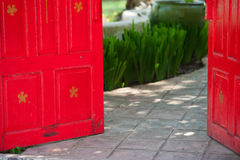 Red open door Stock Images