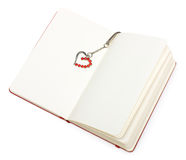 Red open notepad (paper) with heart bookmark Royalty Free Stock Images