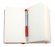 Red open notepad paper with pen. Isolated on white background Stock Images