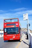 Open topped tour bus, Blue Grotto. Red open topped Maltese Tour Bus at a bus stop, Blue Grotto, Malta, Europe Royalty Free Stock Image
