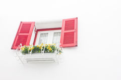 Red open window with white wall. Uprisen angle of red open window with white wall Stock Images