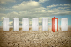 Red opened door among many closed white ones Royalty Free Stock Photography