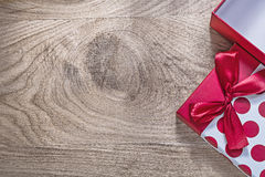 Red opened gift box with bow on wooden board copy space celebrat Royalty Free Stock Photos