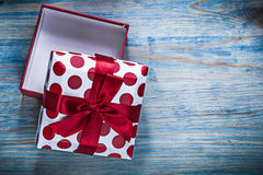 Red opened gift box on wooden board holidays concept.  Royalty Free Stock Photography