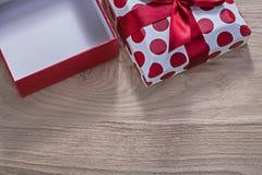 Red opened gift box on wooden board horizontal version celebrati Royalty Free Stock Photo