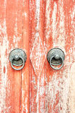A red opened old door with beautiful bronze retro style carved f Royalty Free Stock Photography