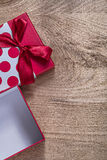 Red opened present box with bow on wooden board celebrations con. Cept Stock Photos