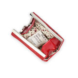 Red opened purse with silica gel Royalty Free Stock Images